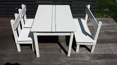 White wooden childrens table with two chairs and bench