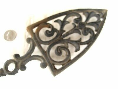 Antique ornate cast iron trivet for sad iron