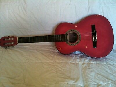 Girls pink acoustic guitar
