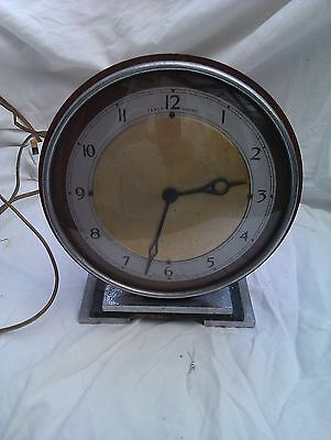 A Small Deco Style Electric Mantle Clock In Full Working Order