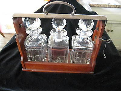 "Betjemann's Tantalus, 3 Crystal Decanters 12 3/4""l, 11 3/4""h, With Working Key"
