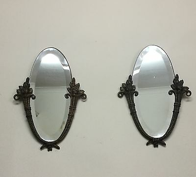 A Pair Of French Oval Wall Mirrors In The Manner Of Edgar Brandt
