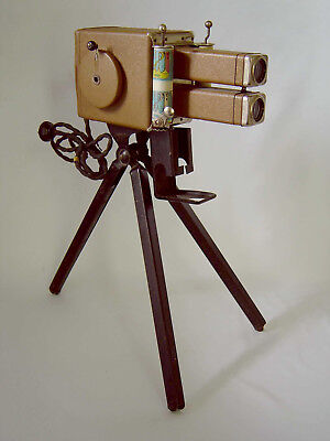 VINTAGE UNCLE SAM'S MOVIE PROJECTOR w/TRIPOD & 10 FILMS; FINE CONDITION, WORKING