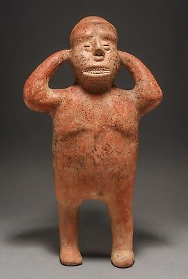 A Rare Pre-Columbian Colima Standing Figure of a Cargador (The Scream).