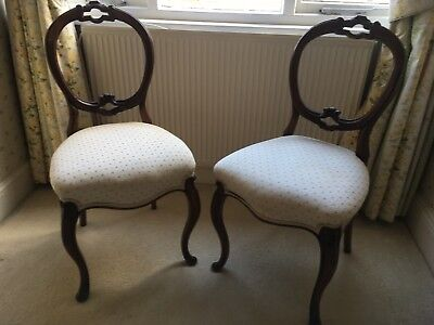 A pair of Victorian Period Balloon Back Chairs - Re-Upholstered.