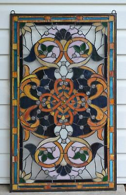 """20.5""""W x 34.75""""H Handcrafted Jeweled stained glass window panel."""