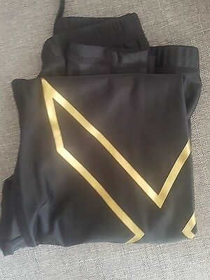 New women's 2XU branded size Medium Gold compression tights