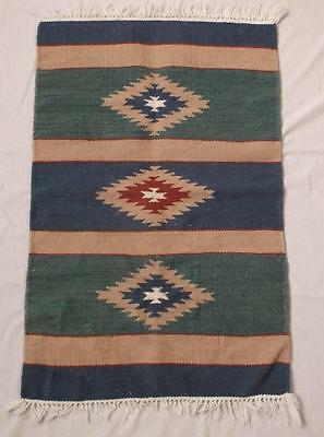 Hand woven wool southwestern USA rug, blue, bluegreen, mauve and red