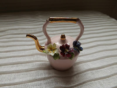 Small china kettle with floral design