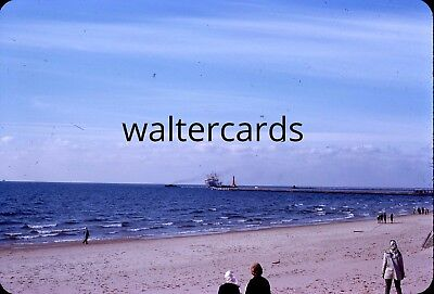 DYNACOLOR 35mm Slide 1960s 1962 lots of people beach watching boat capsizing ?