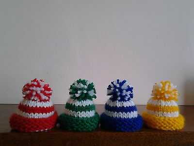 4 Hand Knitted Egg Cosies.