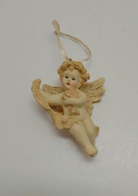 Discontinued Avon Cherub with Bouquet of Flowers Christmas Ornament 1996