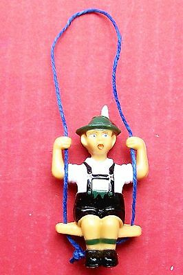 Swinging German boy pendulum for a small novelty type cuckoo clock.