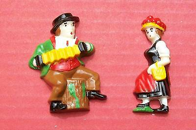 New plastic figurines pair for front of cuckoo clock.