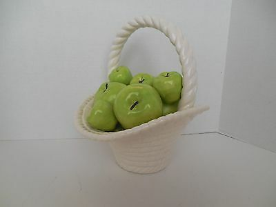 Ceramic basket with green apples