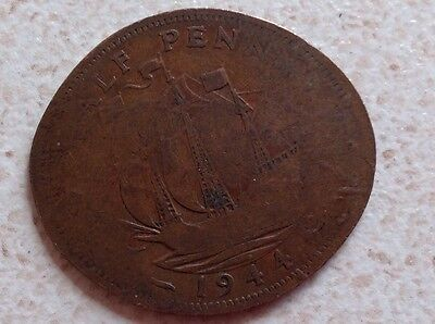 1944 George VI British halfpenny ship half pence rolled and pressed coin.
