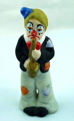 Clown figural playing Saxophone