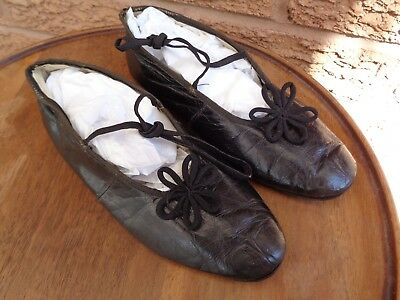 A pair of very sweet antique 19th century girls black kid shoes