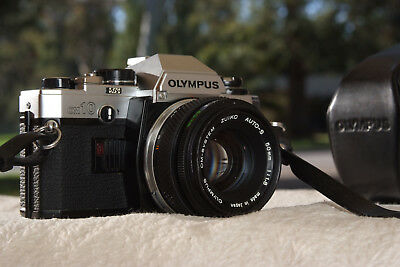 Olympus OM10 with manual switch, cover and 50mm 1.8 lens
