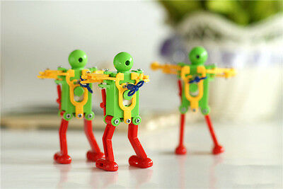 Real Ritzy Child Plastic Clockwork Spring Wind Up Dancing Robot Toys Gift ET