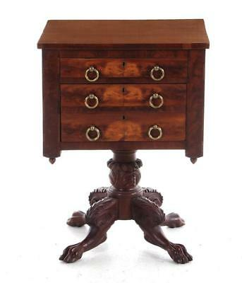 Classical carved mahogany worktable Lot 122