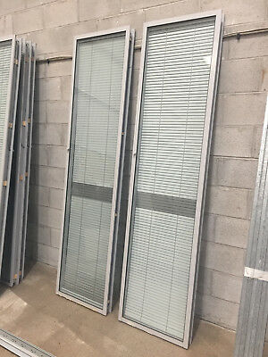 Selection of used office glass / glass office partitions with internal blinds