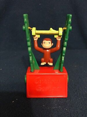 vintage curious george  push botton swing toy tm & universal studios and or hmco