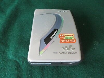 SONY EX194 WALKMAN CASSETTE PLAYER with panasonic headphones working well