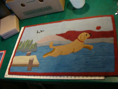 "Rug, 19 x 32"" DOG JUMPING OFF PIER TO GET BALL, i dont think it is very old ??"