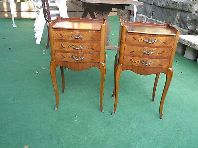 A pair of antique French inland marquetry bedside tables