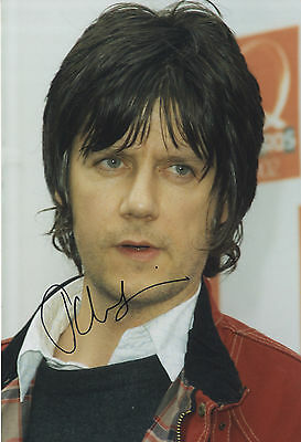 John Squire  ' The Stone Roses '  In Person Signed Colour Photograph.