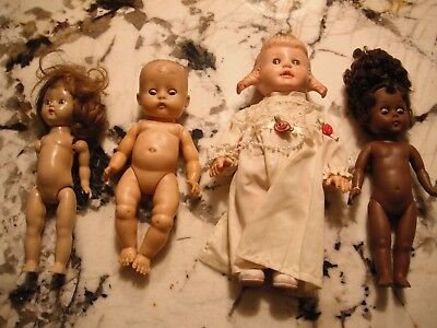 vintage lot of small baby dolls- 4 in lot