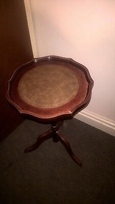 Antique style - pedestal table with leather inlay.