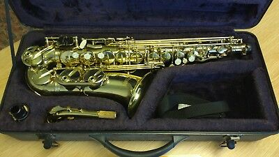 Alto Saxaphone with case and book