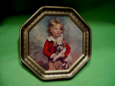 """Vintage Victorian BOY in RED with adorable dog printed on metal. 12.25 """" high."""