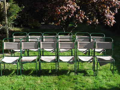 12 x Vintage retro Industrial PEL stacking chairs green frames.