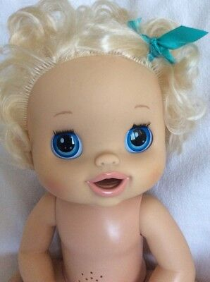 Hasbro Baby Alive 2010 Real Surprises Blonde Curly Hair Bow Doll Talks Big Eyes