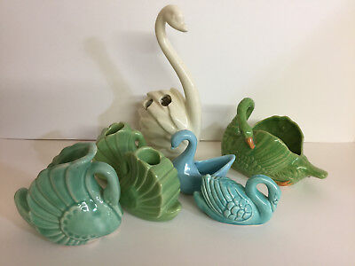 Collection of seven vintage ceramic swans, candle holders, planter, etc.