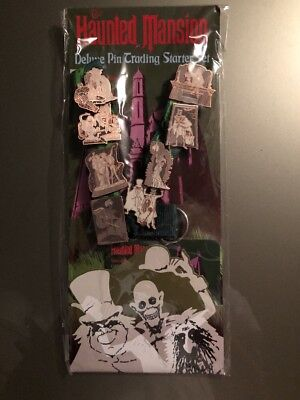 Disney haunted mansion deluxe pin trading starters  set 8 pins and lanyard new