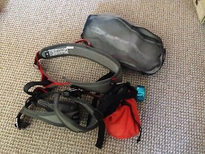 climbing harness with chalk bag and carabiner and blue guide slightly used
