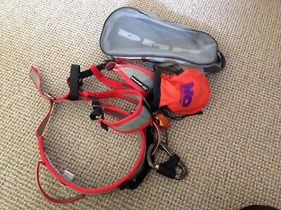climbing harness with chalk bag and carabiner and orange guide slightly used