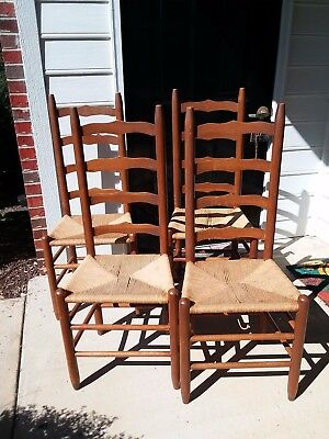 Antique ladderback chairs with rush seating. Set of 4. At least 40 + years old.