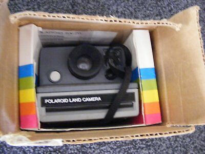 Vintage Polaroid Land camera The Button instant Camera