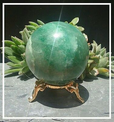 Green aventurine gemstone sphere with gold stand