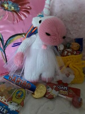 Unicorn knitted toy with sack of sweets