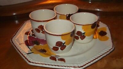 Vintage China egg cups on plate