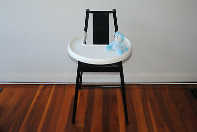 Wooden high chair with colorful cushion