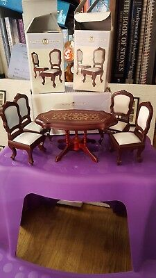1:12th scale dolls house dark wood effect table and 4 chairs with cream silk...