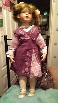 Sonia - Knightsbridge Collection porcelain doll on stand