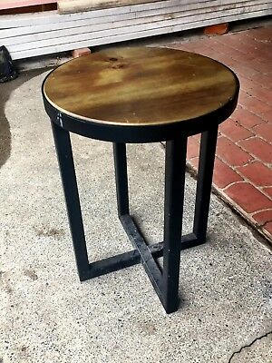 Small round iron and timber coffee tables
